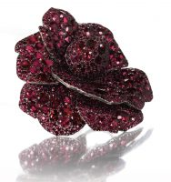 A_ruby_and_diamond_Camellia_flower_brooch_by_JAR_2003